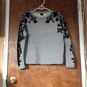 Grey sweater with black velvet swirl detailing